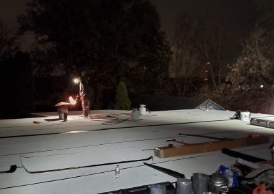 Elgin Flat Roof Replacement working around the dark