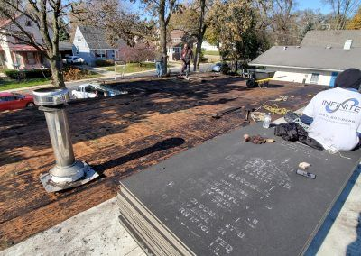 Replace Elgin Flat Roof deck replacement